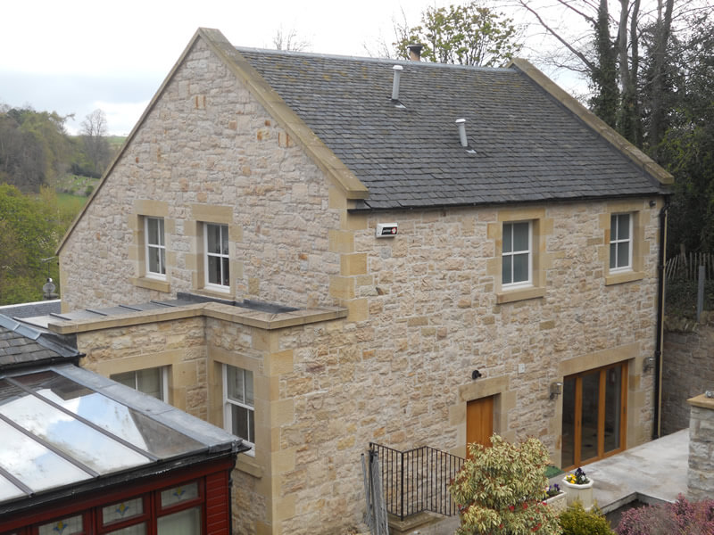 Stonework extension with lead and pitched roof