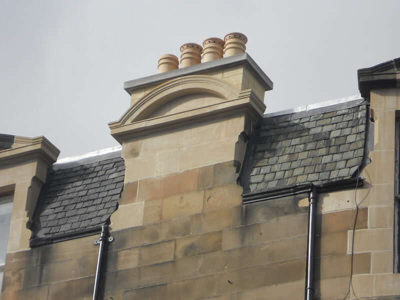 Moulded natural stone chimney