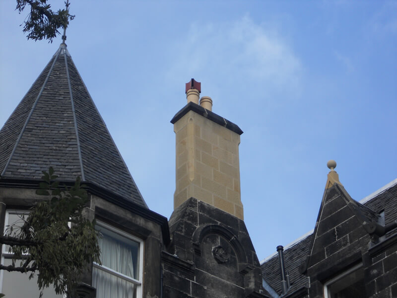 New stone chimney and scotch slating